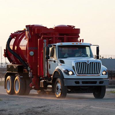 Industrial Vacuum Truck Rolling through