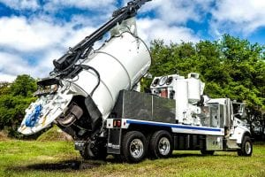 Hydro-Excavator Truck with raised tank dumping load